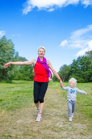 ramble: A woman with a child on the sports outing