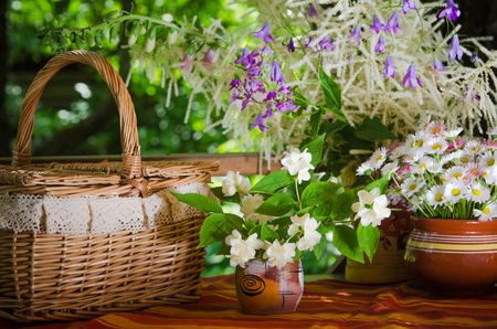 ronantic: A bouquet of daisies in a pot on the table for a picnic