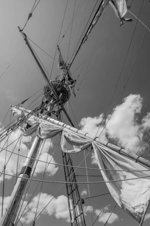 brig ship: Mast with sails of an old sailing vessel, black and white photo