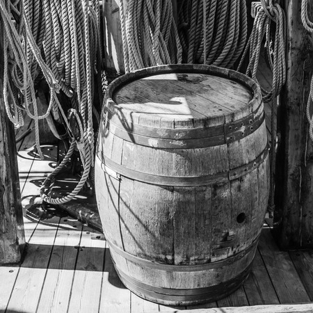 an old wooden barrel on the deck of a sailboat