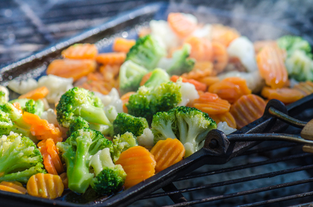 broiling: Vegetables fried on coals, close up. Note: Shallow depth of field
