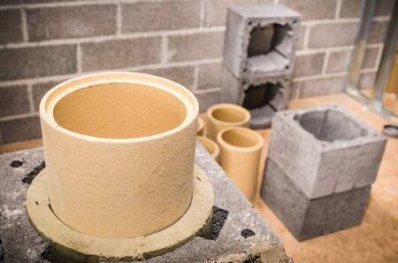 brick house: Construction of modular ceramic chimney in the house