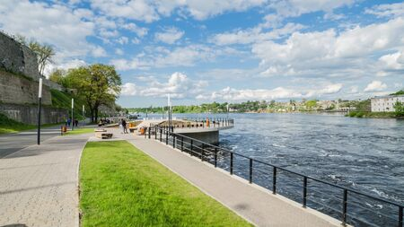 vacationers: NARVA, ESTONIA - MAY 22 2015: Narva River embankment with vacationers people and the border of Russia and the European Union Editorial