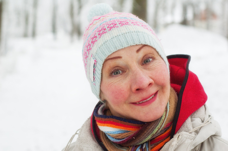 Portrait of a woman in a winter park photo