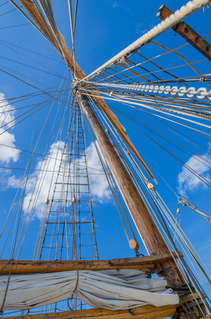 Folded sail and mast on an old sailboat Foto de archivo