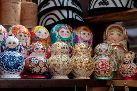 Group of Matryoshka dolls on a market stall.