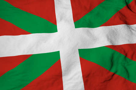 Full frame close-up on a waving Basque flag (ikurrina) in 3D rendering. Imagens