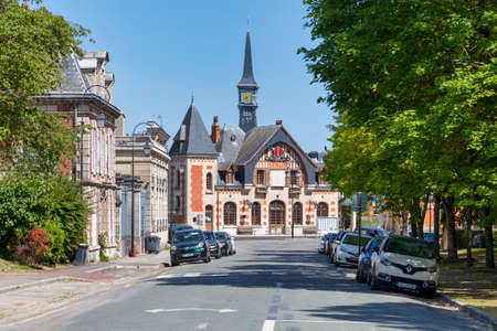 Senlis, France - May 19 2020: Former Senlis railway station used now as bus station next to the former banque de France now used as Medical Center.