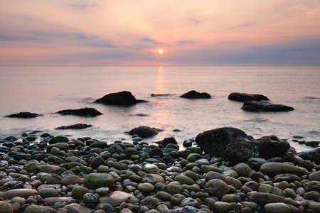 Sunset at the rocky beach at Hayburn Wyke, North Yorkshire Coast, United Kingdom Archivio Fotografico