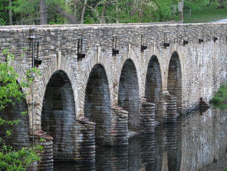 Stone Bridge dam crossing calm lake