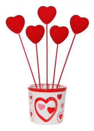 Five love hearts in pot  Stock Photo