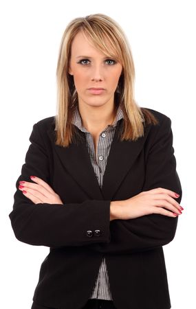 stern: Business woman with arms folded looking at camera Stock Photo