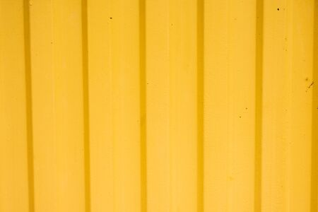 Empty yellow metal door background and texture 免版税图像