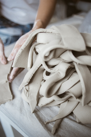workroom: Clay grey cuttings in pottery studio Stock Photo