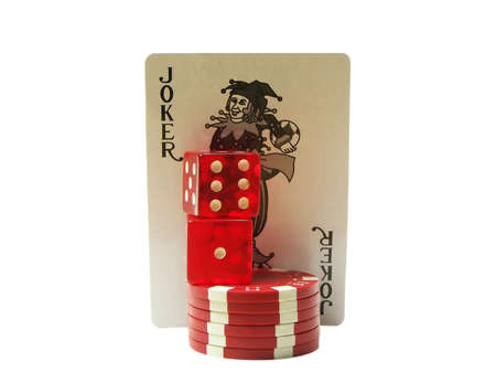 Photo of a stack of red poker chips and a pair of dice with a joker card behind them isolated on a white background Stock Photo - 657093