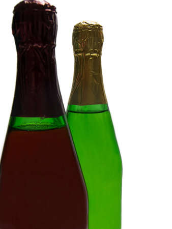 Photo of two different flavored champagne bottles isolated on a white background