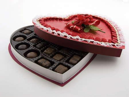 Photo of a open heart shaped box of chocolates Stock Photo