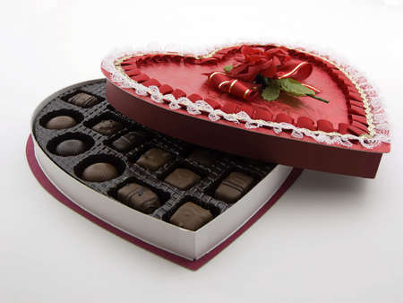 box of chocolates: Photo of a open heart shaped box of chocolates Stock Photo