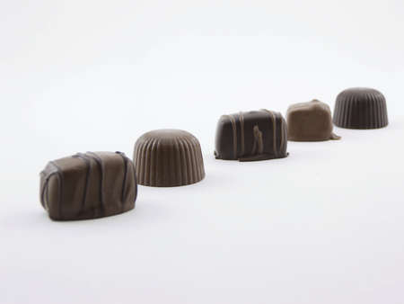 Photo of five pieces of chocolate lined up at an angle