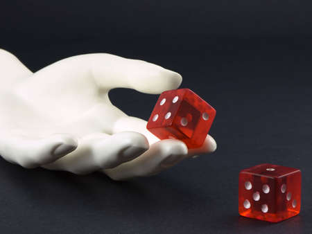Photo of a hand rolling a pair of dice Stock Photo - 706145