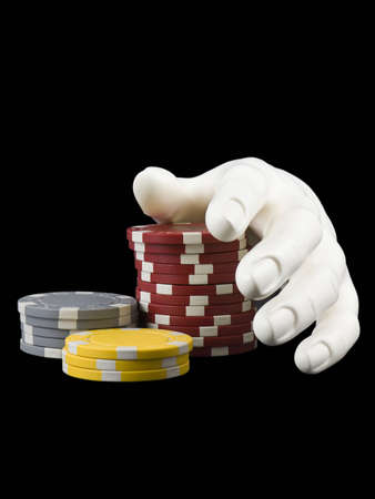 Photo of a hand near several poker chips isolated on black Stock Photo - 706202