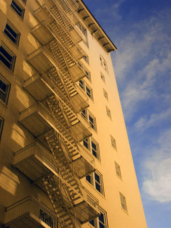 escapes: Photo of a buildings side with fire escapes