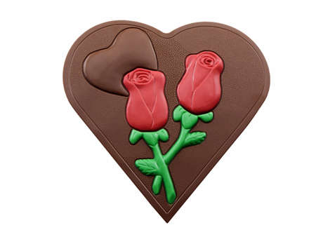 Photo of a chocolate heart with two chocolate red roses, isolated on a white background