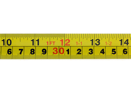 inches: Photo of the one foot mark, twelve inches, on a tape measurer, isolated on white