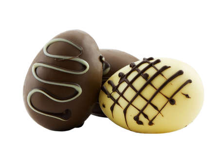 Photo of three chocolate gourmet easter eggs isolated on white