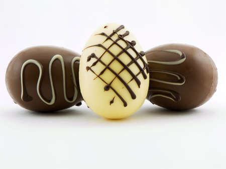 Photo of three gourmet chocolate easter eggs shot on a white background