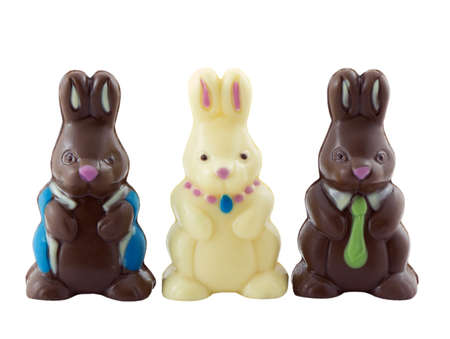 Photo of three chocolate easter bunnies isolated on white