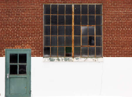 Photo of a rustic window and door on the side of a building Imagens