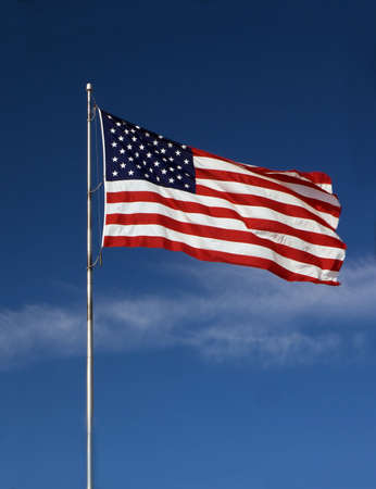Photo of an American flag blowing in the wind photo