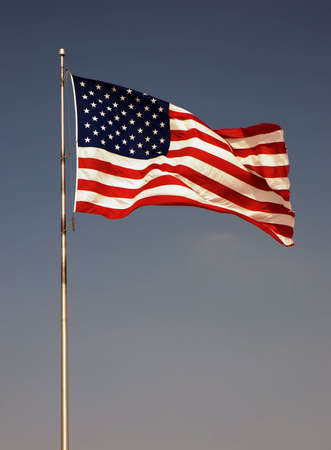 Photo of an american flag blowing in the wind