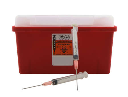 Photo of a sharps container and two needles isolated on white