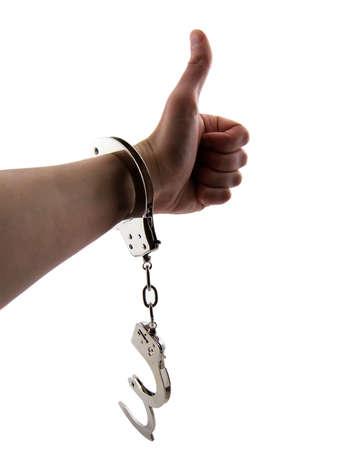 cuffed: Foto mans de un brazo con una esposas y en un pulgar, aislados en blanco