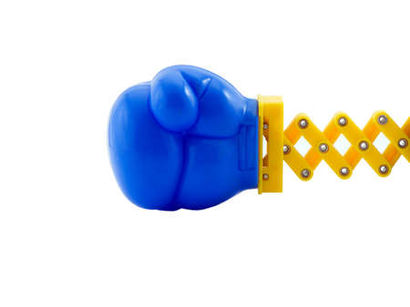 Photo of a boxing glove on a retractable arm, isolated on white Stock Photo