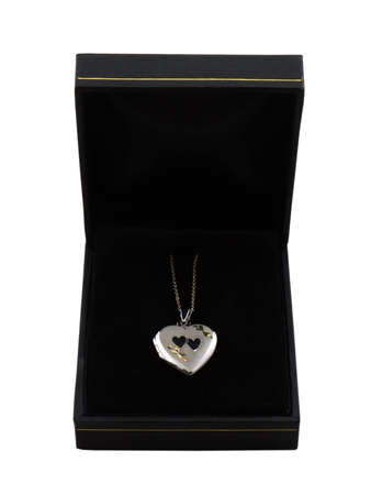 Photo of a locket necklace in a jewelry box isolated on white