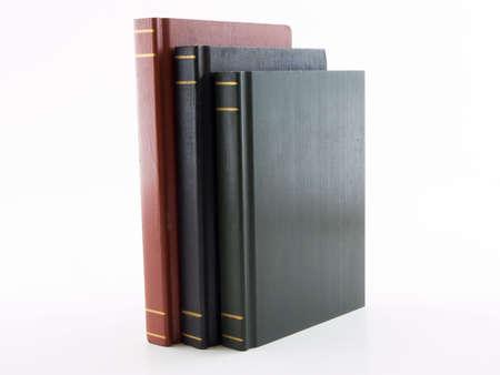 Photo of three books standing, shot on a white background 版權商用圖片