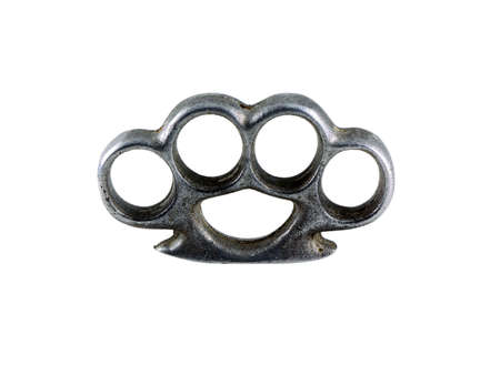 Photo of a pair of brass knuckles isolated on white