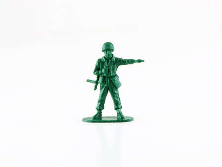 plastic soldier: Photo of an army man isolated on white