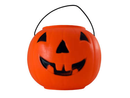 Photo of a halloween pumpkin pail isolated on white
