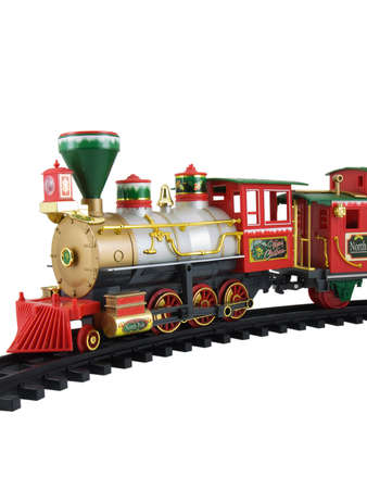 Photo of a christmas themed train on train tracks isolated on white Stock Photo