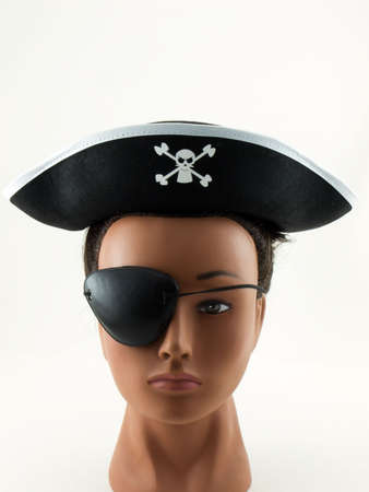Photo of a female mannequin head with a pirate hat and eye patch on