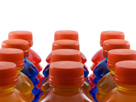 Photo of orange, blue, and red bottled drinks isolated on white Banco de Imagens - 868393