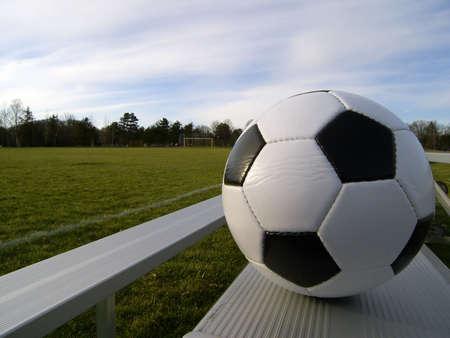 bleachers: Photo of a soccer ball on empty bleachers next to a soccer field Stock Photo
