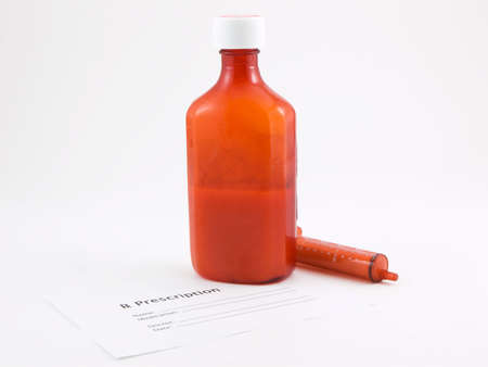 Photo of a bottle of medicine, syringe and a prescription