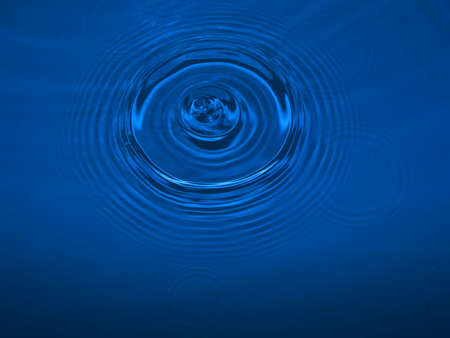 Photo of a water drop making ripples Stock Photo