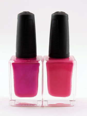 2 つの白い背景の上にピンクのマニキュア ボトル 写真素材 - 953677