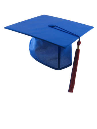 Graduation hat and tassle isolated on white